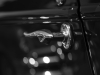 Door handle detail, antique car. Black and white photo © Andrée Fredette