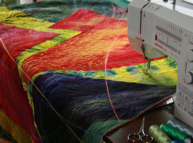 Texturing a quilt... obsessive work. Quilt and photo by Andrée Fredette