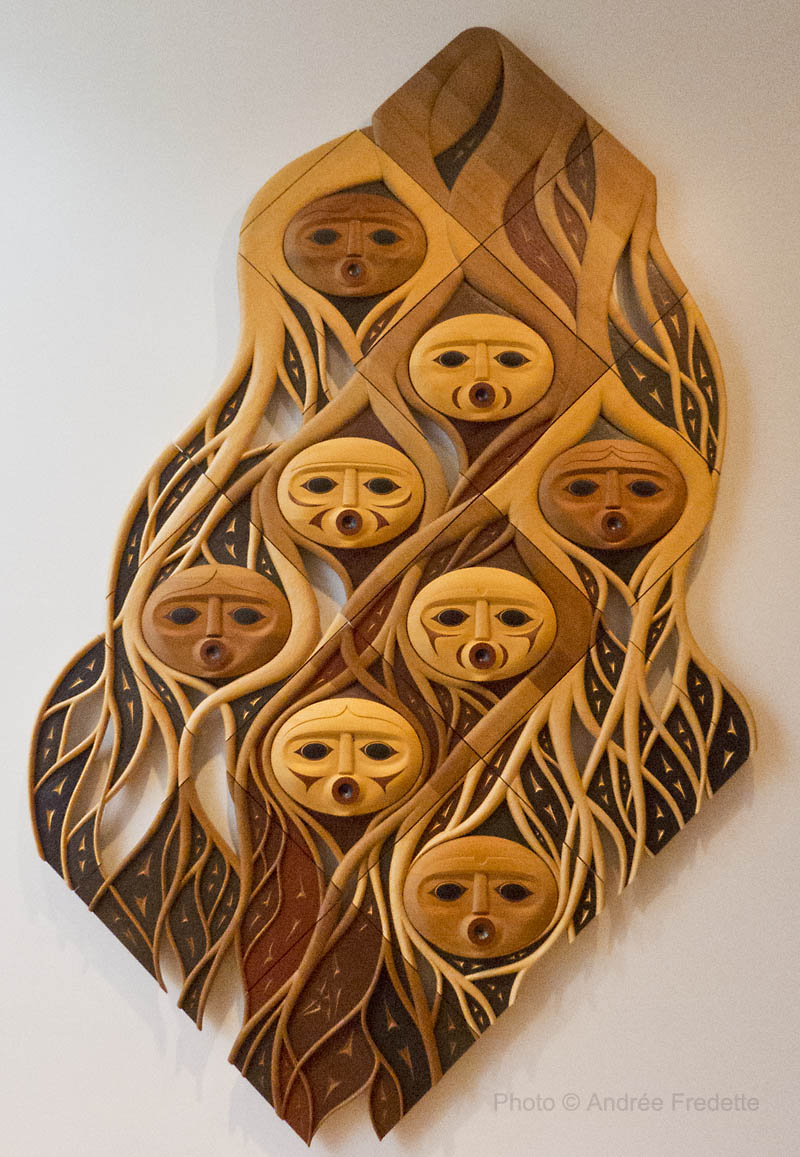 The First People, by Susan Point. Red and yellow cedar. Photo © Andrée Fredette