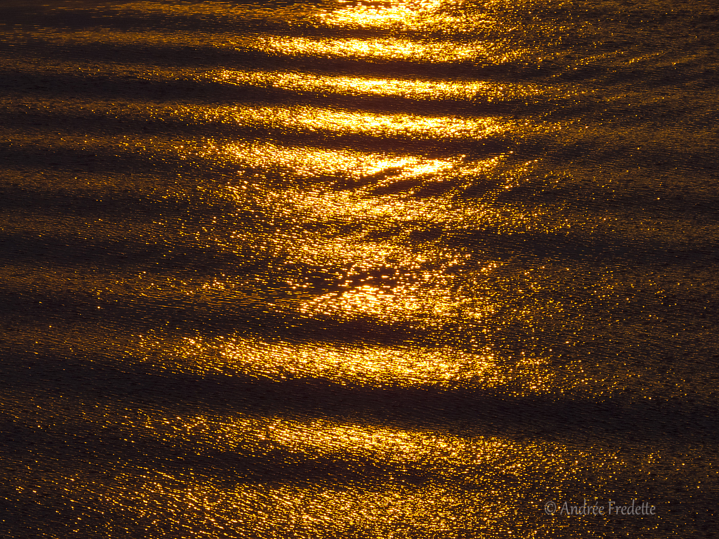 Sunset reflected in the water. Photo by Andrée Fredette