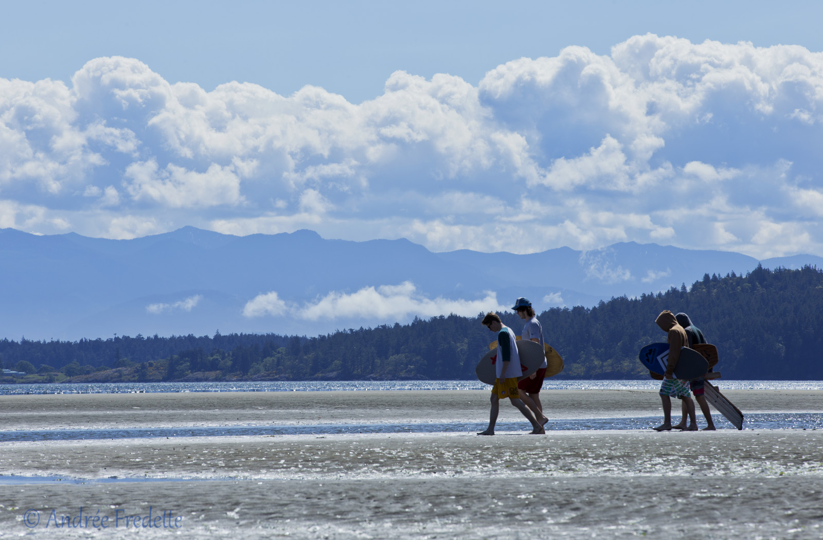 Boogie board teens, on the way to the water's edge, Witty's Lagoon, Vancouver Island, BC. Photo by Andrée Fredette